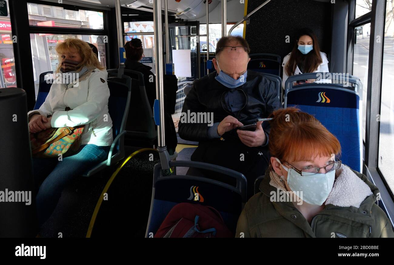 Jena, Germany. 06th Apr, 2020. Passengers of a regular bus. From 06.04.2020, persons in public places are obliged to wear a mouthguard. Credit: Sebastian Willnow/dpa-Zentralbild/dpa/Alamy Live News Stock Photo