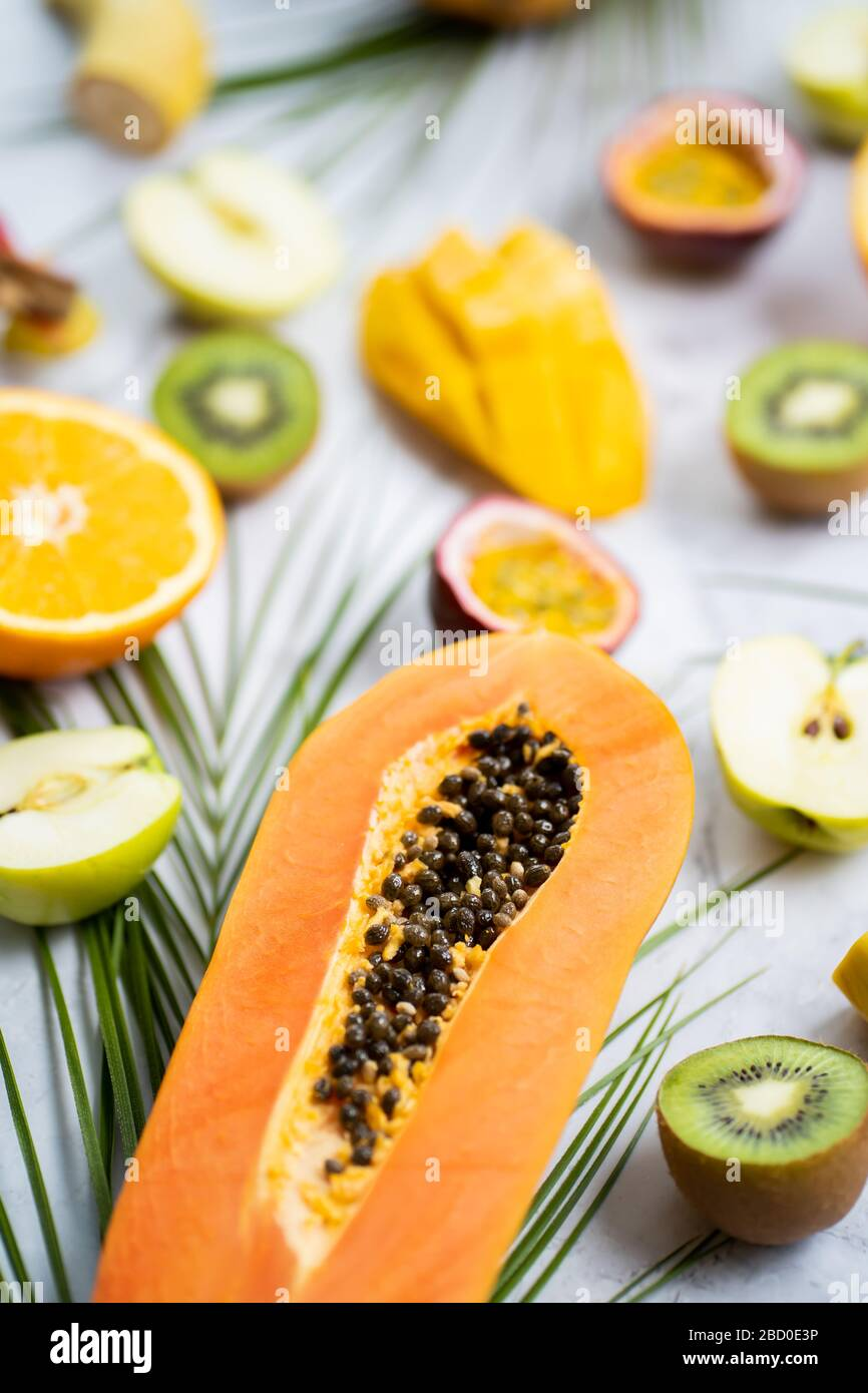 Assorted Ripe Juicy Fresh Tropical Summer Seasonal Fruits And Tropical Leaves On White Background Exotic Asian Fruits Sliced Fruits On Table Select Stock Photo Alamy