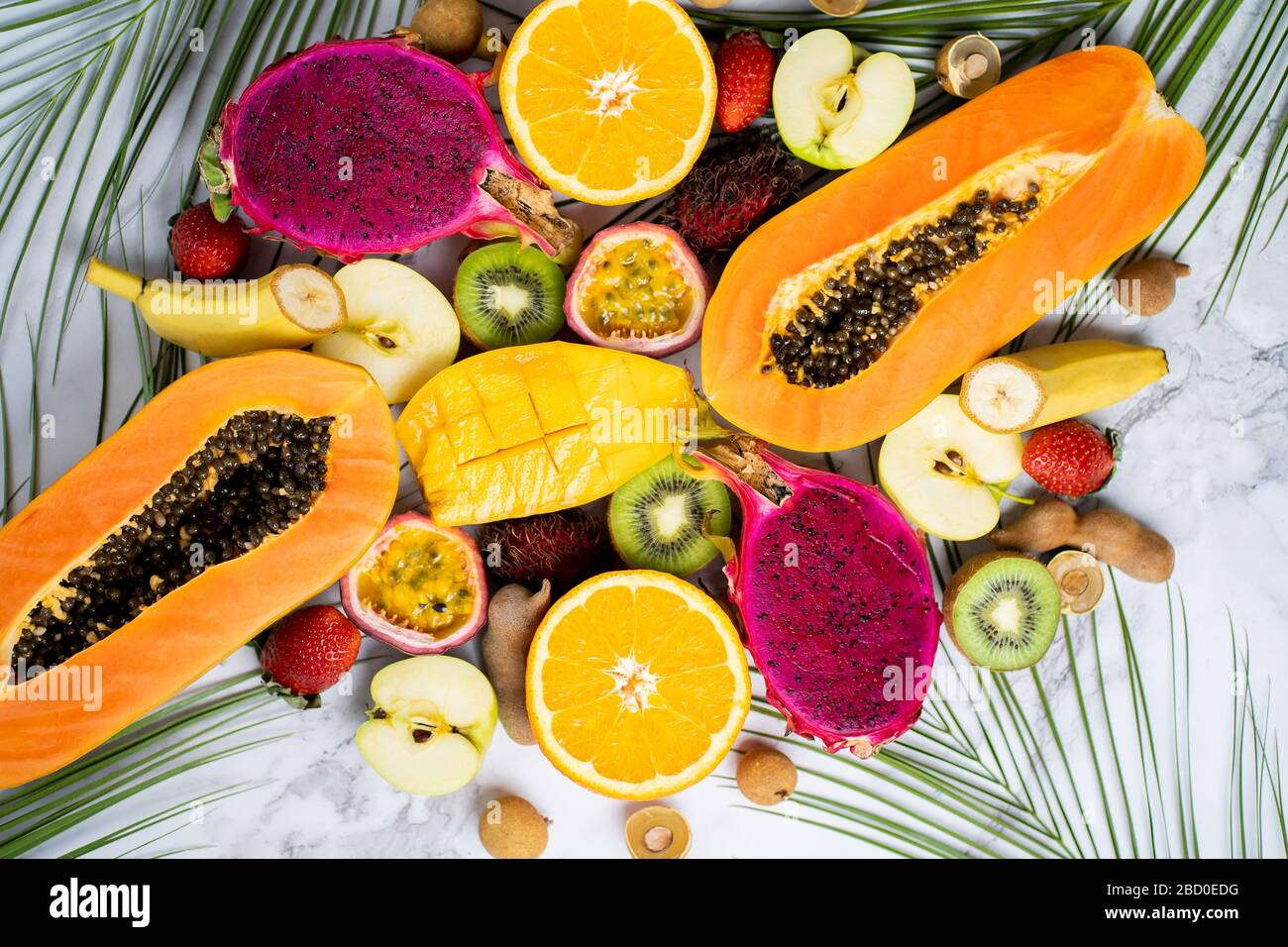 Assorted Ripe Juicy Fresh Tropical Summer Seasonal Fruits On White Background Vacation Healthy Food Dieting Summer Concept Sliced Fruits On Table Stock Photo Alamy