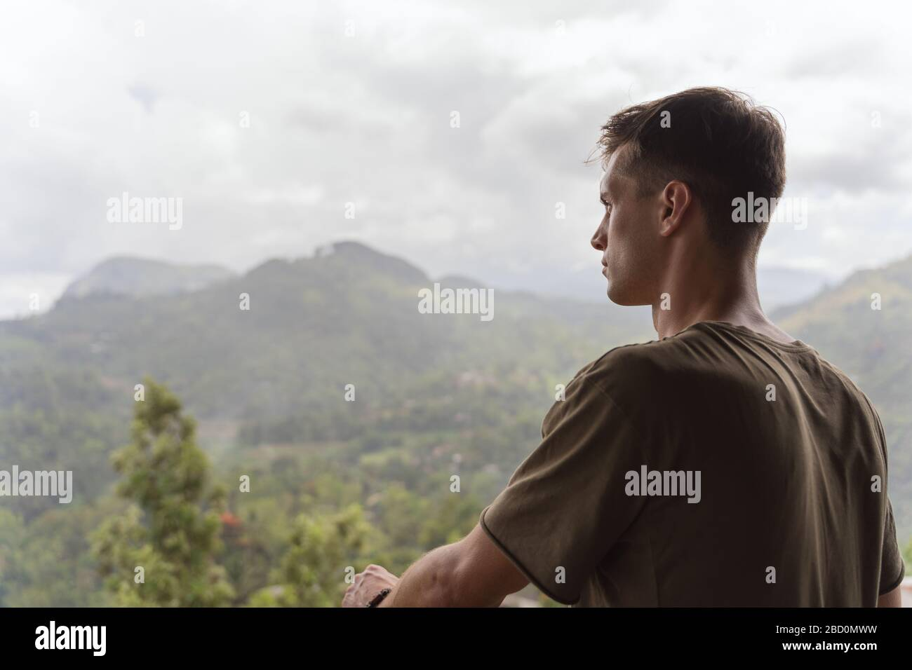 young adult admiring the beautiful nature in a tropical location. Wanderlust Stock Photo