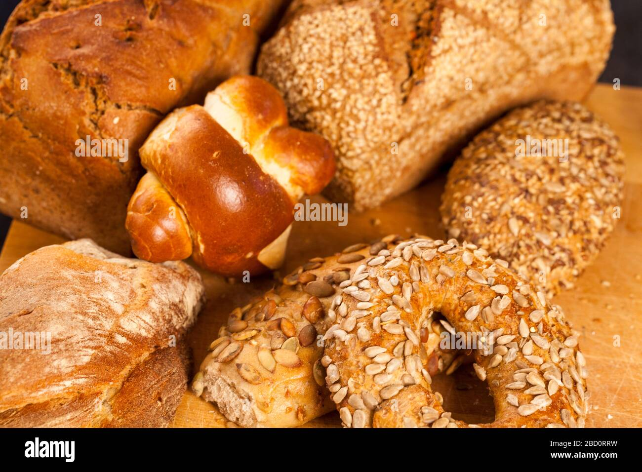 Selection of freshly baked gourmet rolls and loaves of bread Stock Photo