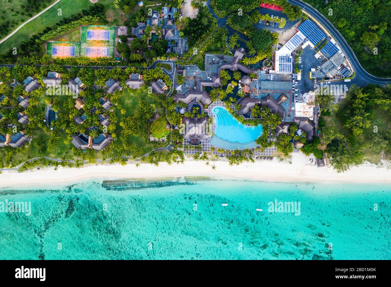 Aerial view by drone of luxury tourist resort on palm-fringed beach facing the tropical lagoon, Le Morne Brabant, Mauritius, Indian Ocean, Africa Stock Photo