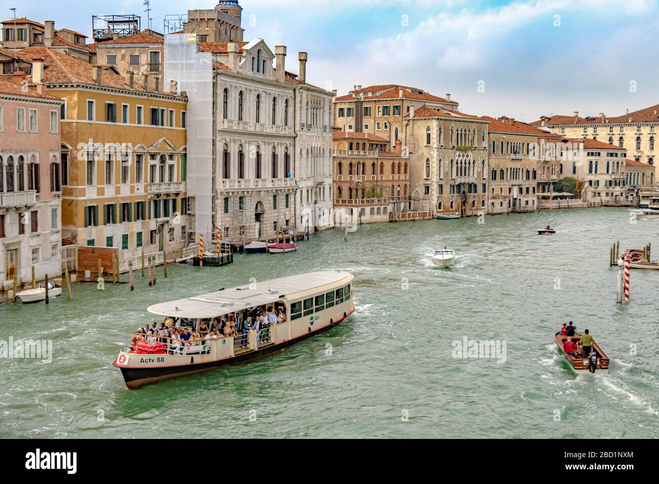 A route No 2  Vaporetto or water bus packed with passengers near Accademia on The Grand Canal in Venice,Italy Stock Photo