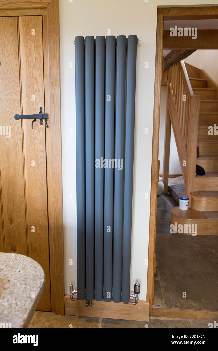 Vertical Radiator On Kitchen Wall Dark Grey Vertical Radiator In A Country Farmhouse Kitchen Stock Photo Alamy