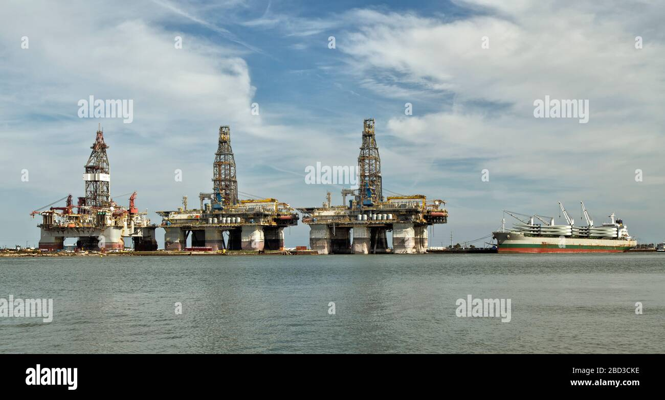 Harbor Island, Canyon Port, three deep water drill rigs in storage,    vessel  anchored, awaiting to unload Giant Wind Turbine Propeller Blades. Stock Photo
