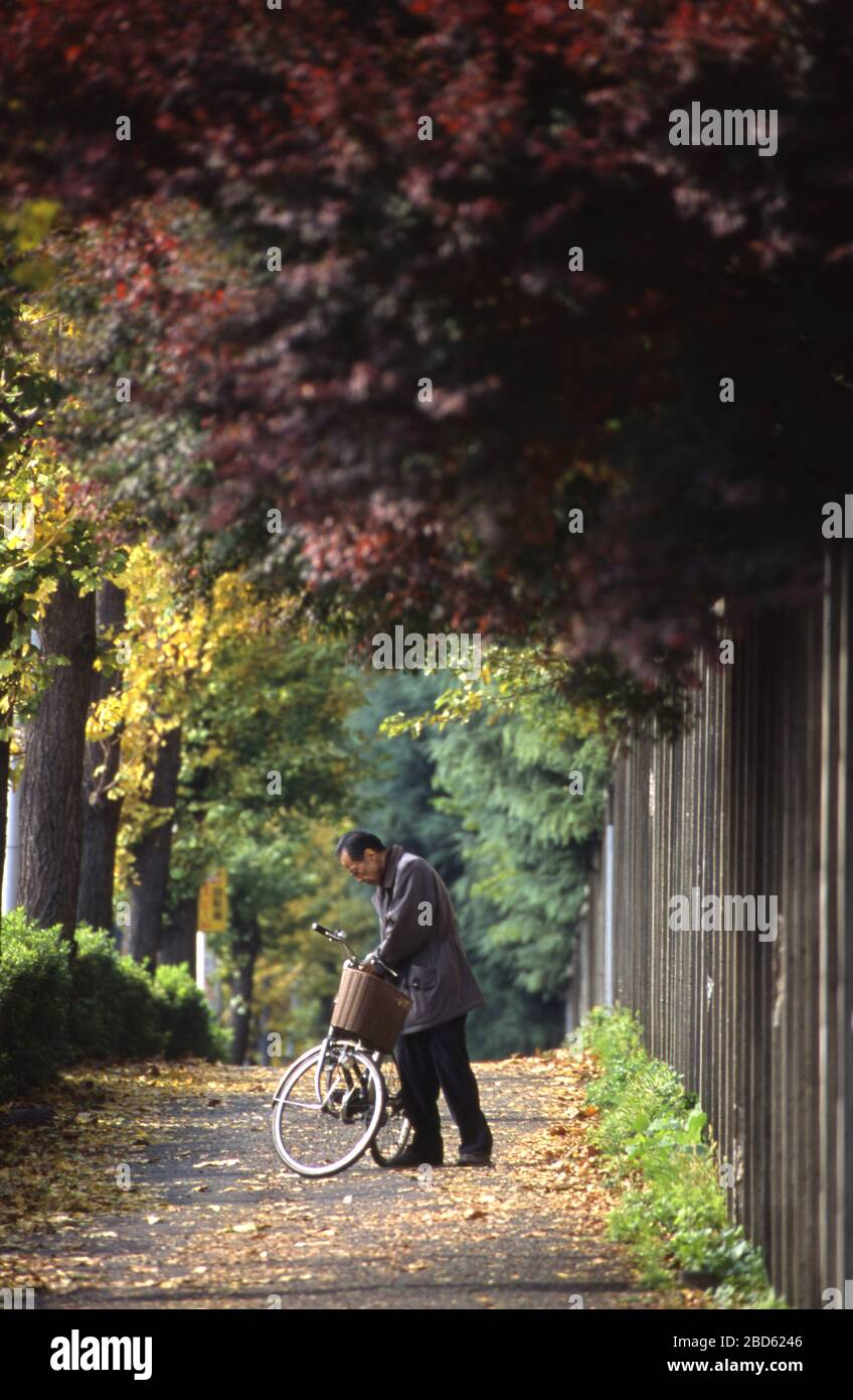 One Man With His Bike On Walkway In Tokyo Japan Stock Photo