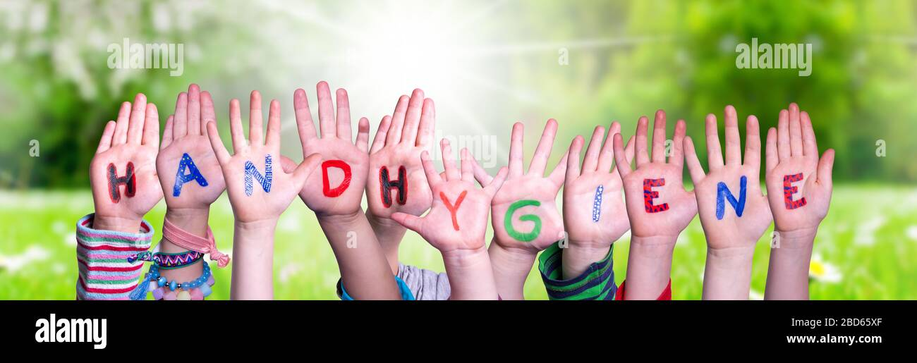 Kids Hands Holding Word Handhygiene Means Hand Hygiene, Grass Meadow Stock Photo