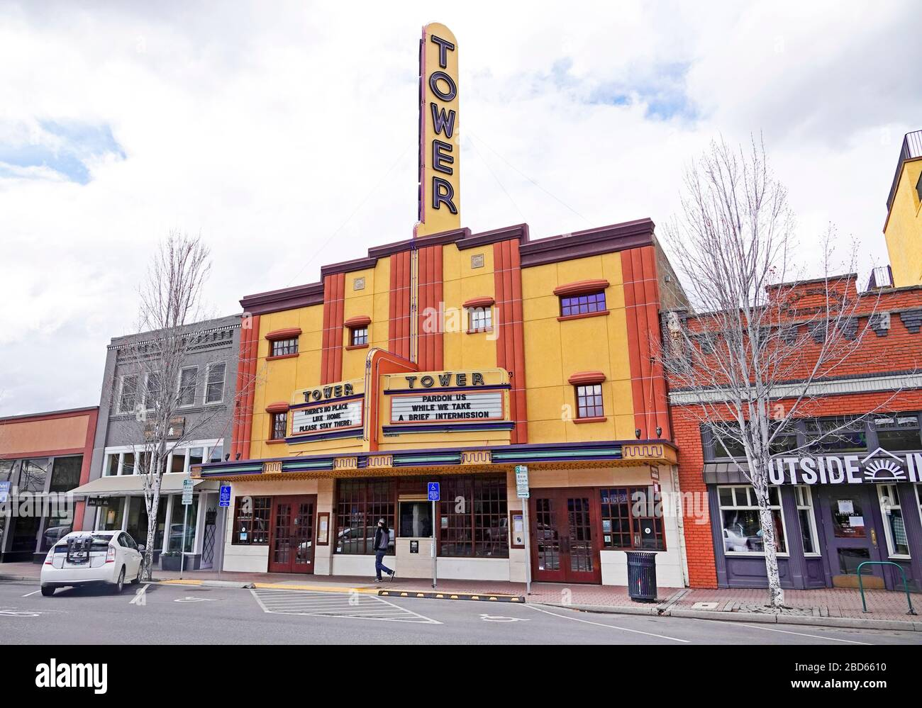 """The event venue Tower Theater in Bend, Oregon, displaying """"Stay Home"""" signs during the Coronavirus pandemic of 2020. Stock Photo"""