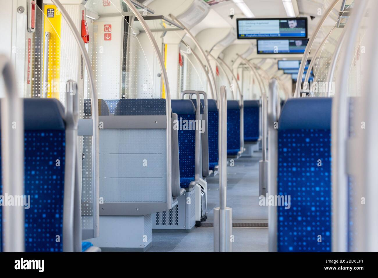 Interior of an empty Munich public transport train (S-Bahn / S Bahn). Due to Covid-19 the usage of public transport in Germany dropped by 80 to 90%. Stock Photo