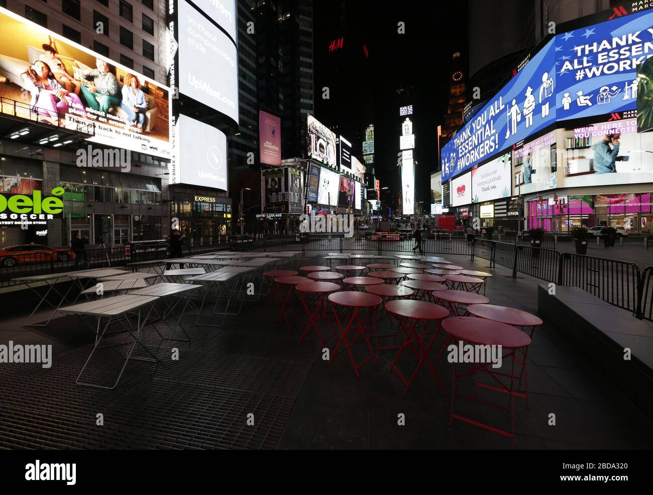 New York, United States. 08th Apr, 2020. Messages celebrating healthcare and essential workers are displayed on the jumbo screens in an almost completely empty Times Square in New York City on Tuesday, April 7, 2020. Coronavirus deaths in the U.S. climb above 12,000 as New York City suffers deadliest day with over 800 dying in the 24 hours since Monday night. Photo by John Angelillo/UPI Credit: UPI/Alamy Live News Stock Photo