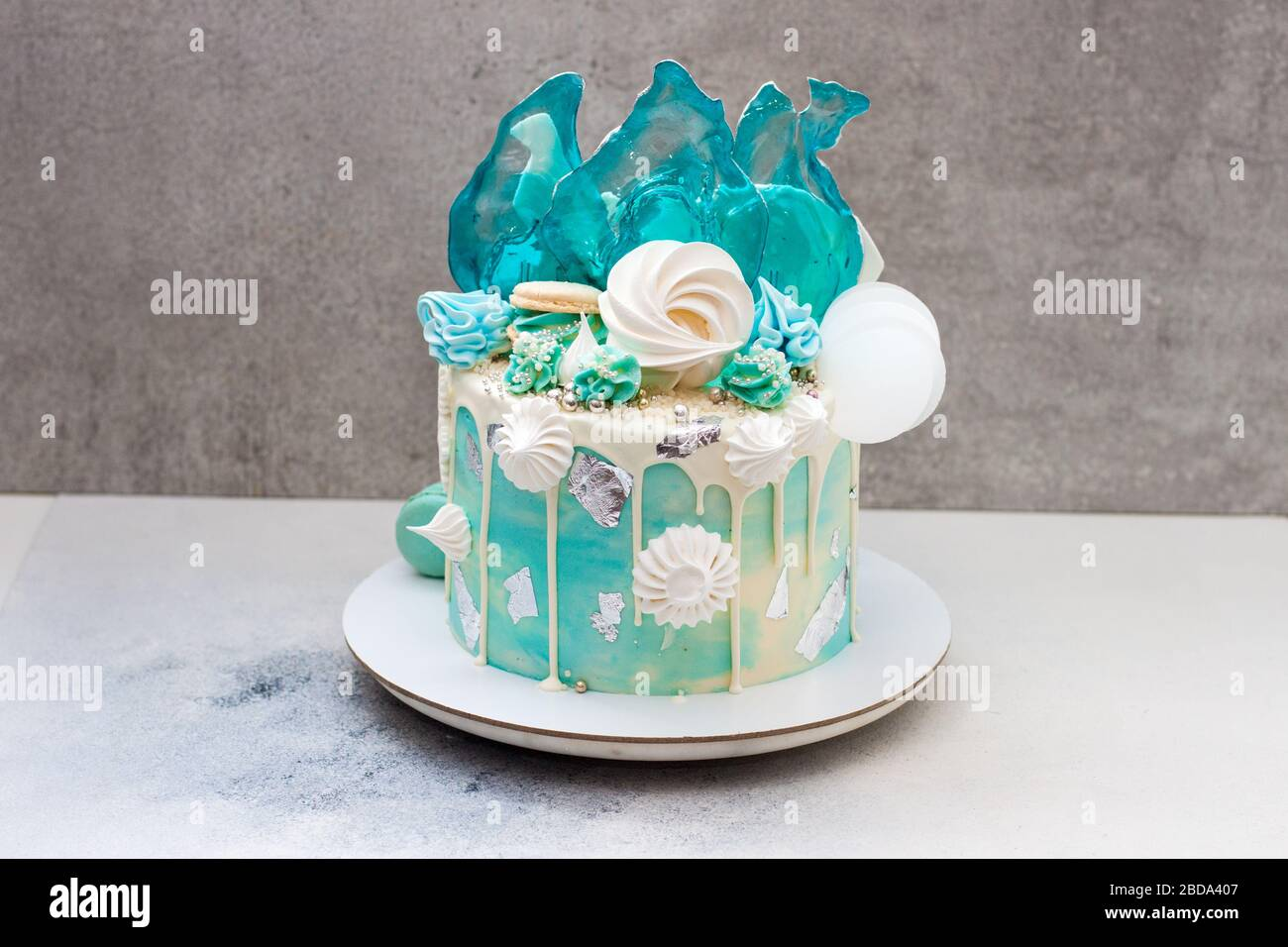 Astounding Modern Frozen Theme Cake Decorated With Blue Caramel White Funny Birthday Cards Online Alyptdamsfinfo