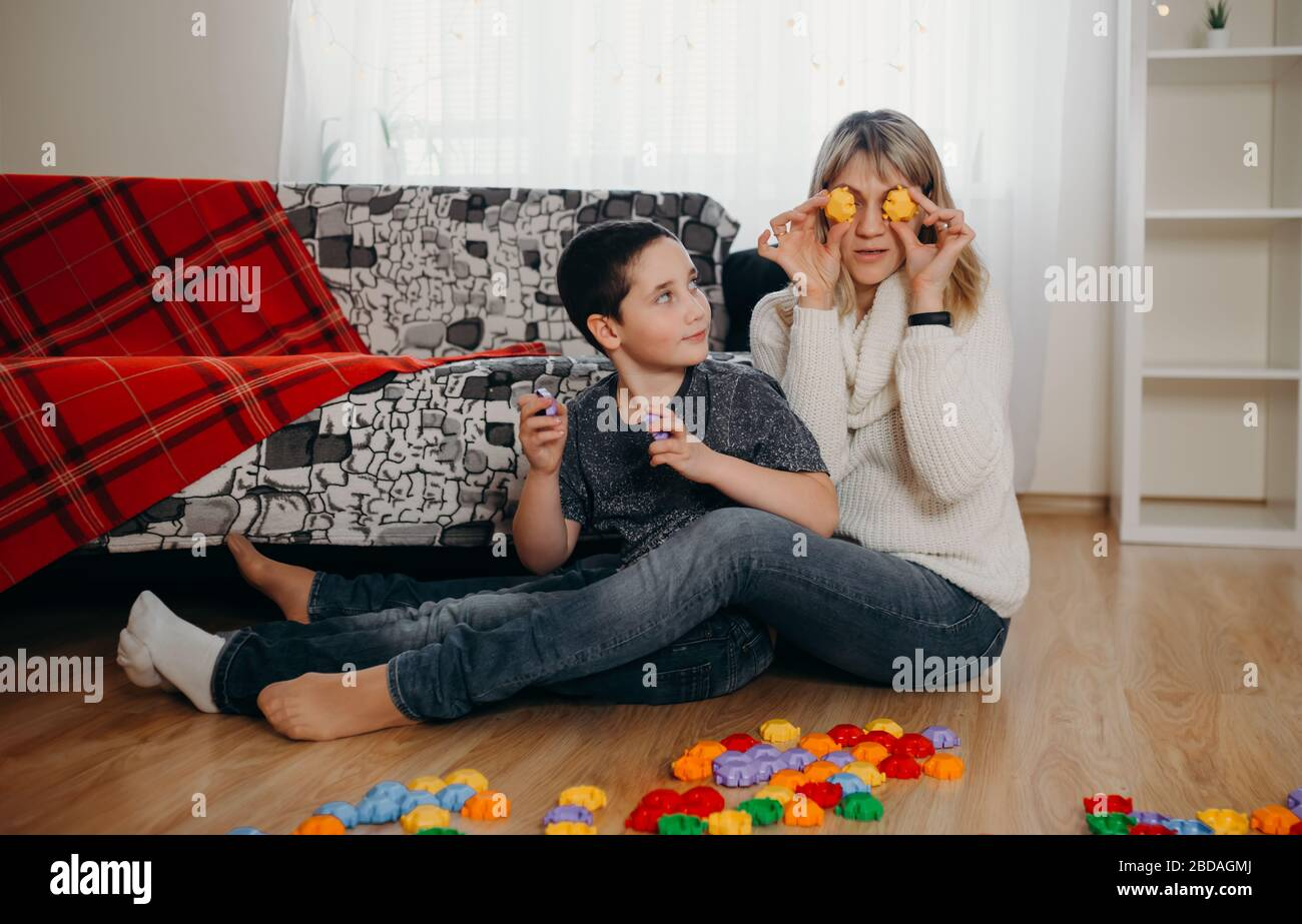 Mother and little boy have fun engaged. Concept of distance education Stock Photo