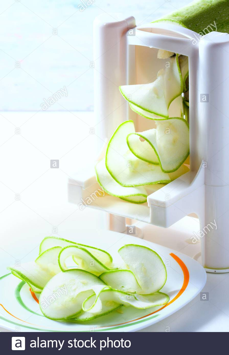 Making zucchini noodles using spiralizer. Selective focus. Stock Photo