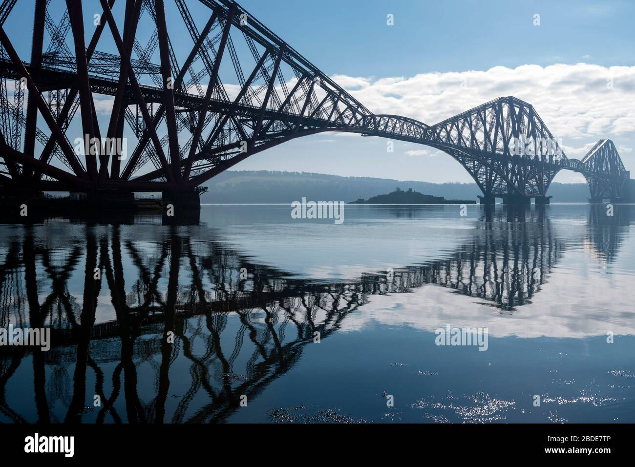 Forth Rail Bridge, with Inchgarvie island visible under span, viewed from the harbour on South Bay, North Queensferry in Fife, Scotland, UK Stock Photo