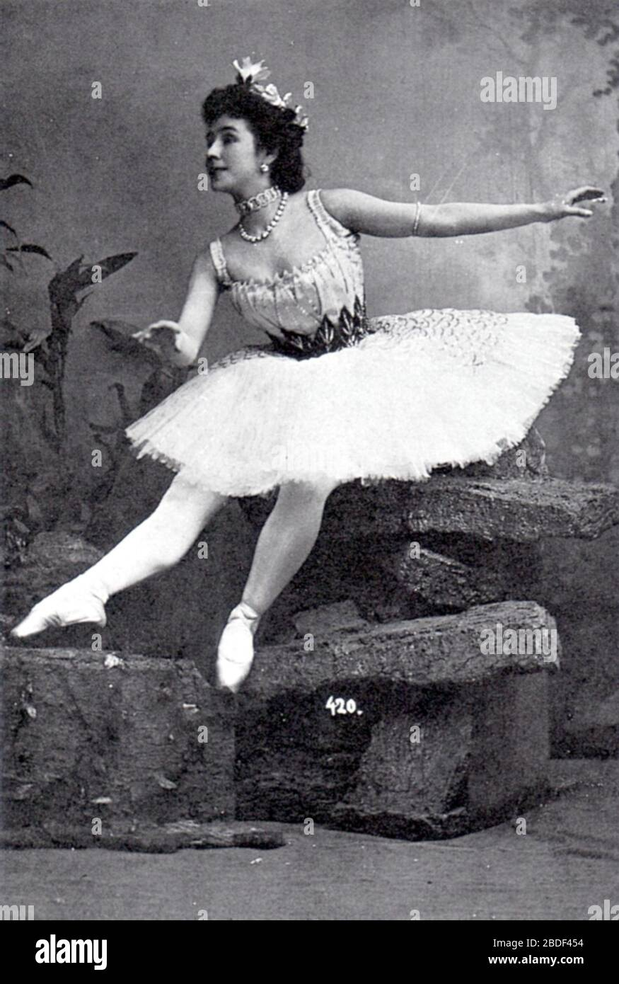 """""""English: Photographic postcard of Mathilde Felixovna Kschessinskaya (1872-1971), Soloist to His Imperial Majesty and Prima ballerina of the St. Petersburg Imperial Theatres. She is costumed as Princess Aspicia in the under-water scene from the 1862 ballet The Pharaoh's Daughter, created by the choreographer Marius Petipa (1811-1910) and the composer Cesare Pugni (1803-1870).; between 1898 and 1900 date QS:P,+1500-00-00T00:00:00Z/6,P1319,+1898-00-00T00:00:00Z/9,P1326,+1900-00-00T00:00:00Z/9; Photo scanned from the 2nd edition of the book Ballet: An Illustrated History by Mary Clarke and Clemen Stock Photo"""