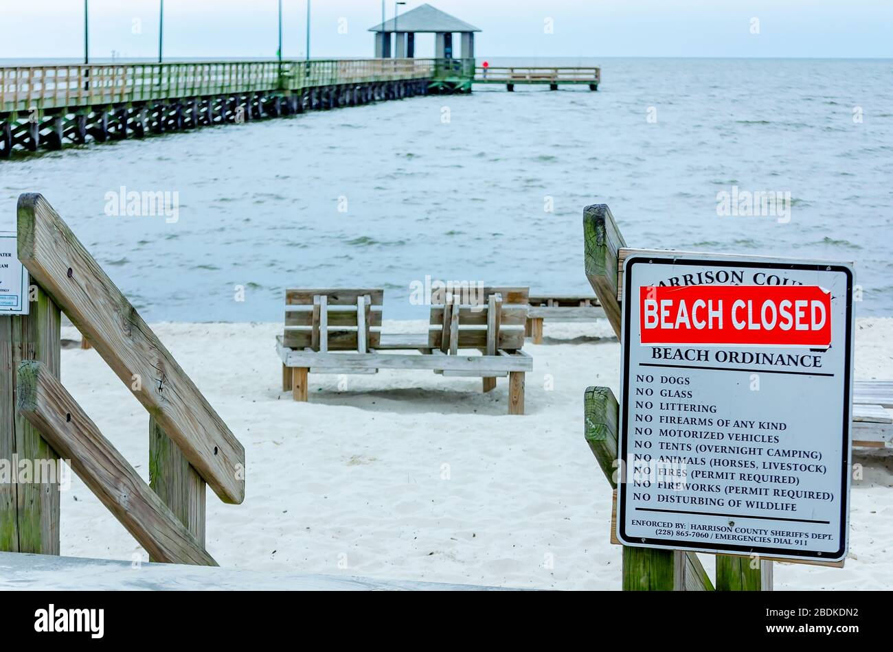 Closed Signs Are Posted On Biloxi Beach At Lighthouse Pier During