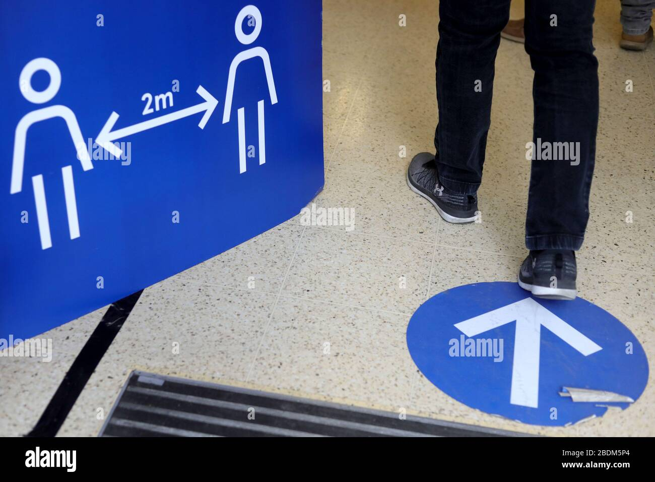 London, UK. 8th Apr, 2020. Photo taken on April 8, 2020 shows signs at a Tesco's store to encourage social distancing in London, Britain. As of Wednesday morning, the number of confirmed cases of COVID-19 in Britain hit 60,733, up 5,492 in the past 24 hours, said the Department of Health and Social Care. Credit: Tim Ireland/Xinhua/Alamy Live News Stock Photo