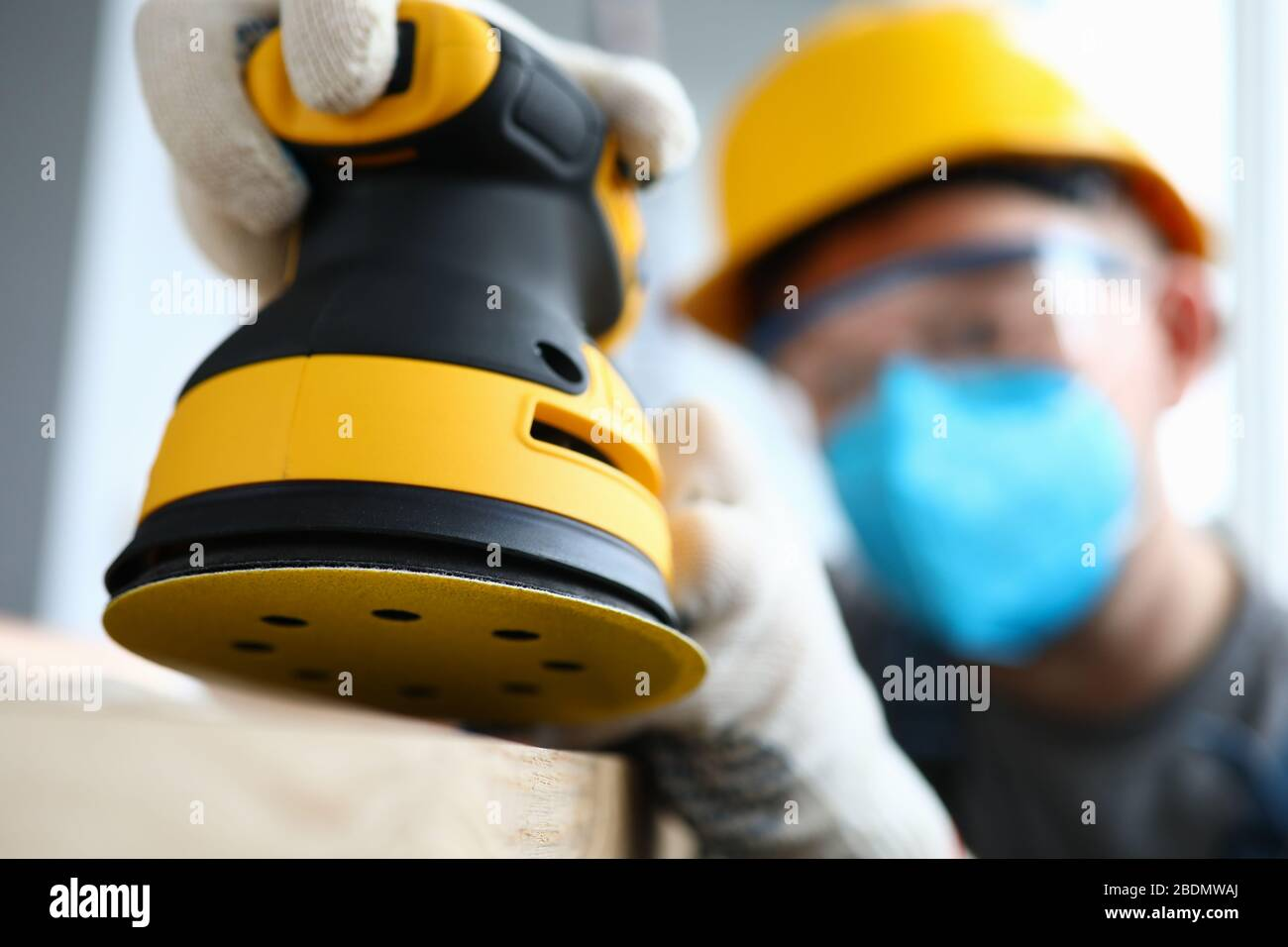 Man in gloves working on renovation Stock Photo