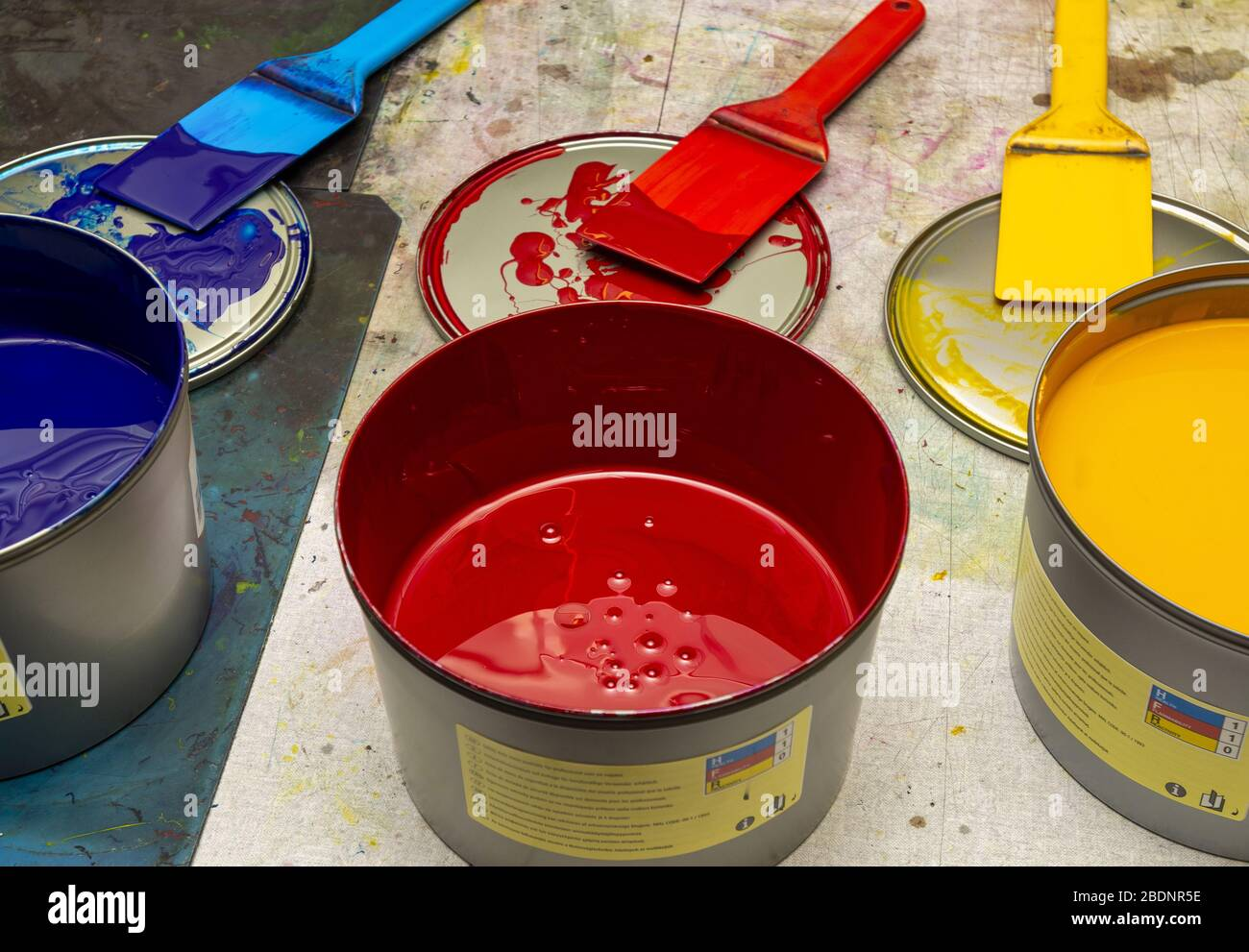 Blue, red and yellow printing ink for Heidelberg four colour printer Stock Photo