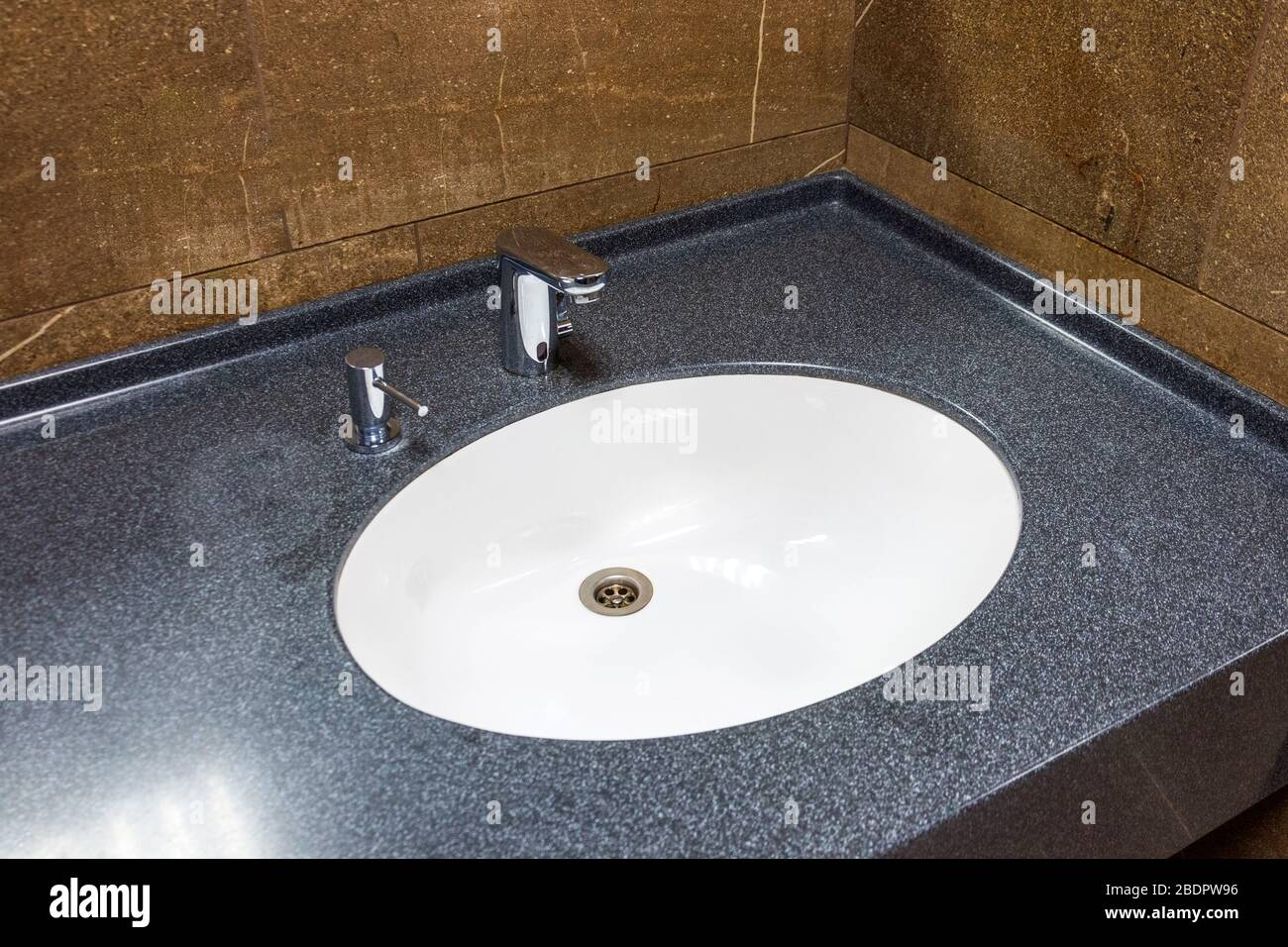 White Sink In Brown Marble Countertop With Chrome Shiny Faucet And Integrated Dispenser For Liquid Soap Stock Photo Alamy