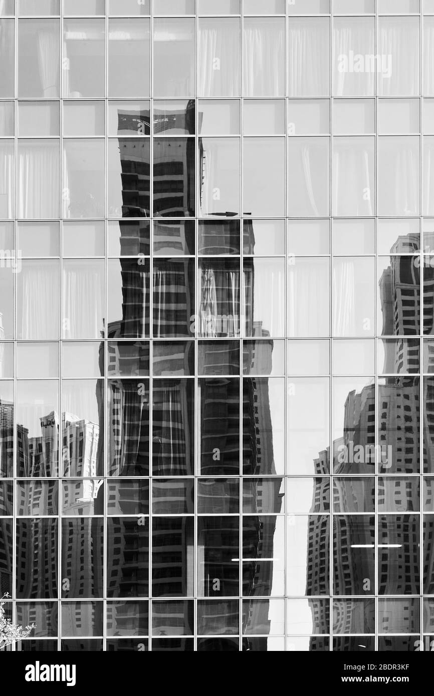 Reflection of towers in the glass wall of a building  -  architectural background Stock Photo