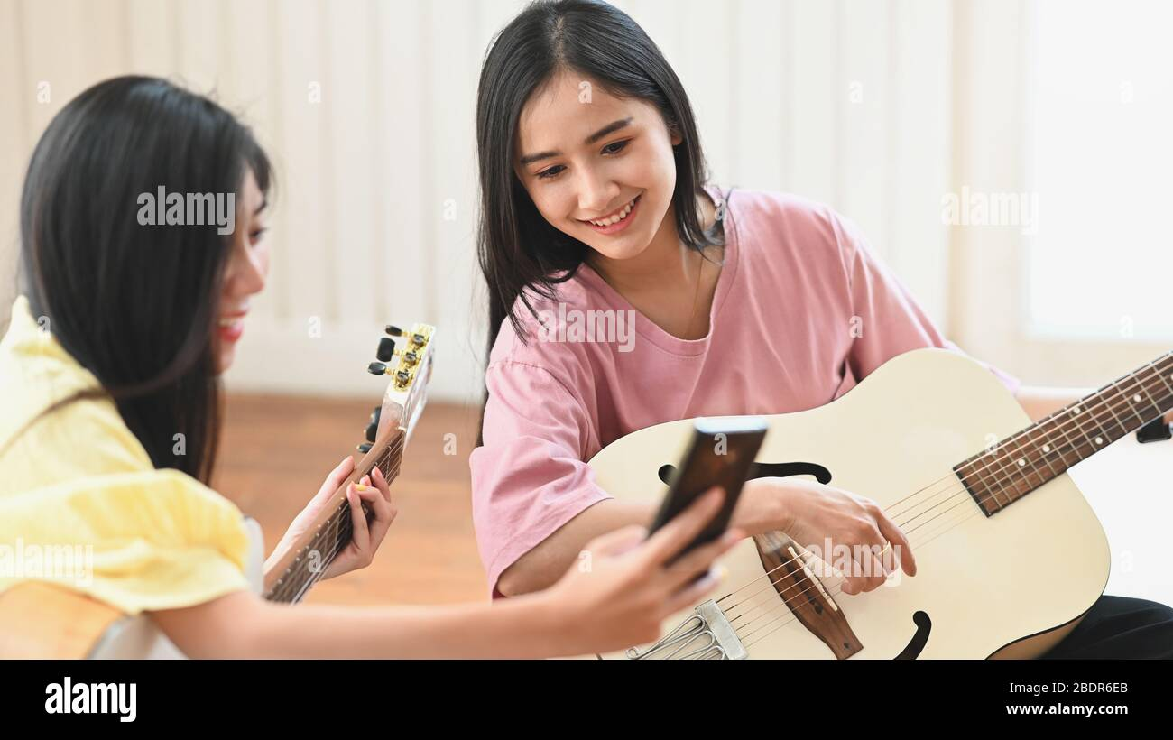 Photo Of Young Women Teaching Learning To Play A Acoustic Guitar