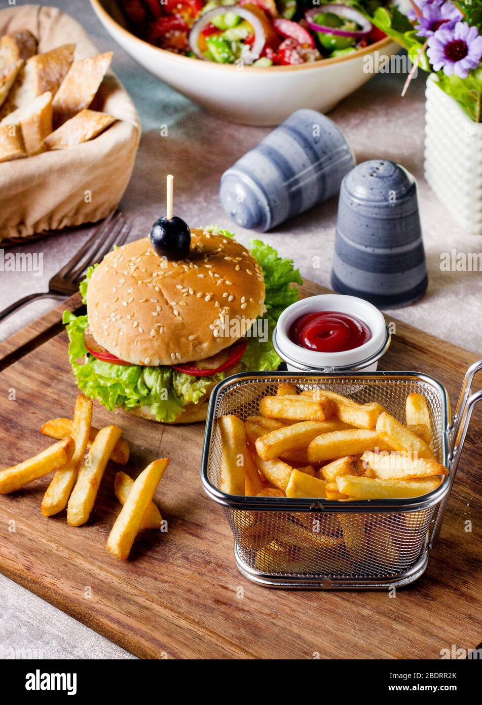 beef burger served with french fries basket Stock Photo