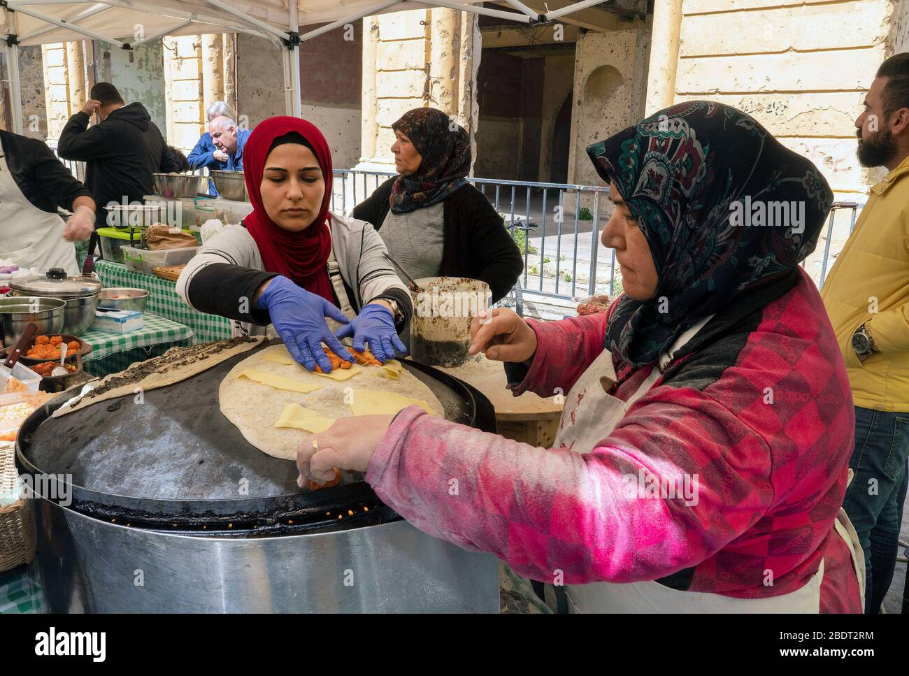 Women making saj bread in Farmers' Market at Beirut Souks Stock Photo