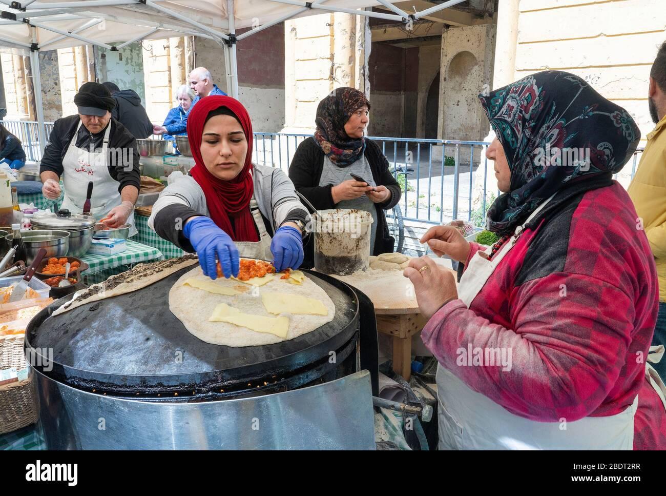 Women making saj bread in Farmers' Market at Beirut Souks Stock Photo