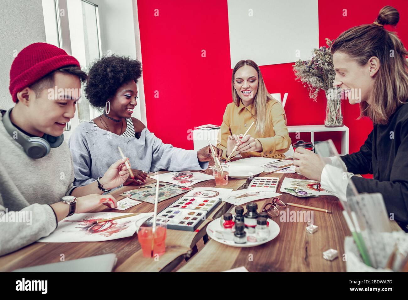 Happy mixed raced people visiting art workshop Stock Photo