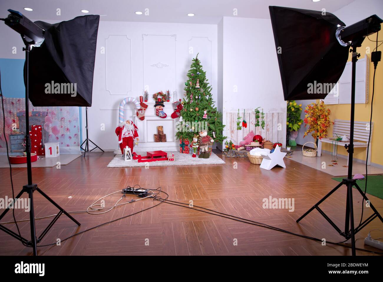 studio photo with softbox . Decorated Christmas room with beautiful tree . New Year's decor and tree in children's playroom. interior of a modern Stock Photo