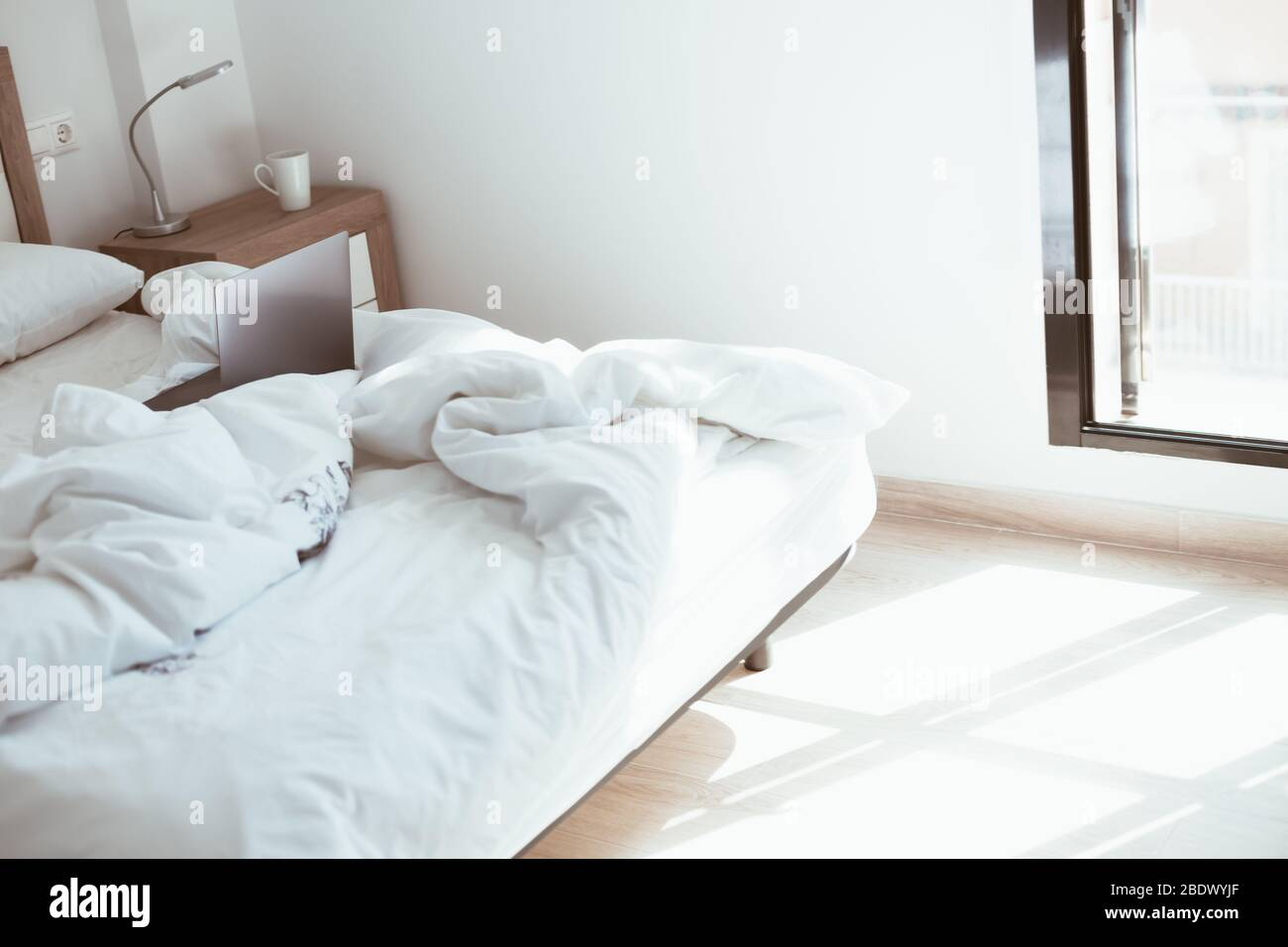 Working Home Quarantine Self Isolation Lockdown Concept Laptop In Unmade Bed Comfortable And Cozy Remote Home Office Modern Apartments With Sunligh Stock Photo Alamy