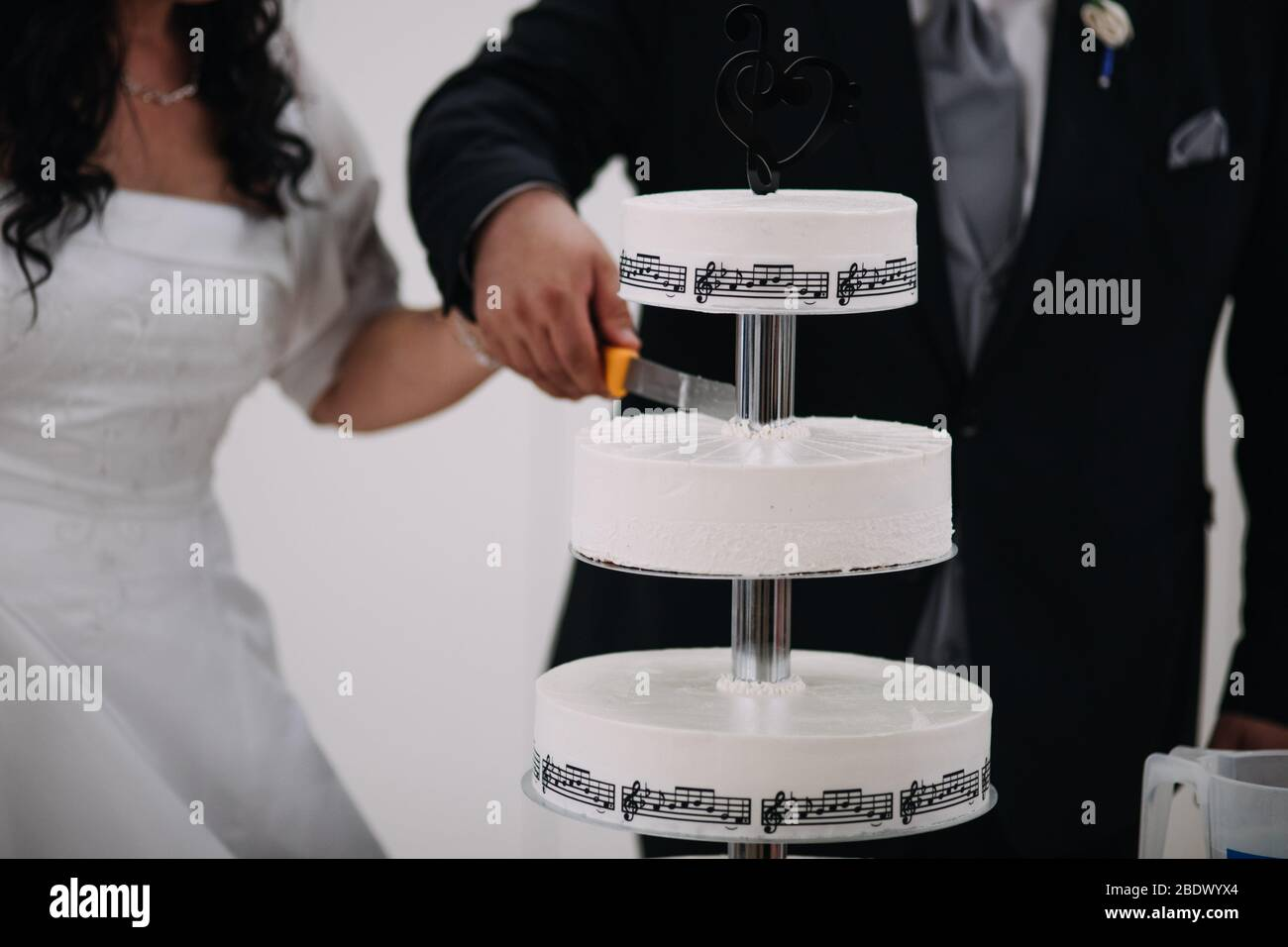 Elegant Wedding Cake Decorated With Music Symbols And Notes Bride And Groom On Background Wedding Ceremony Beautiful Pie On The Table Brides Cut C Stock Photo Alamy