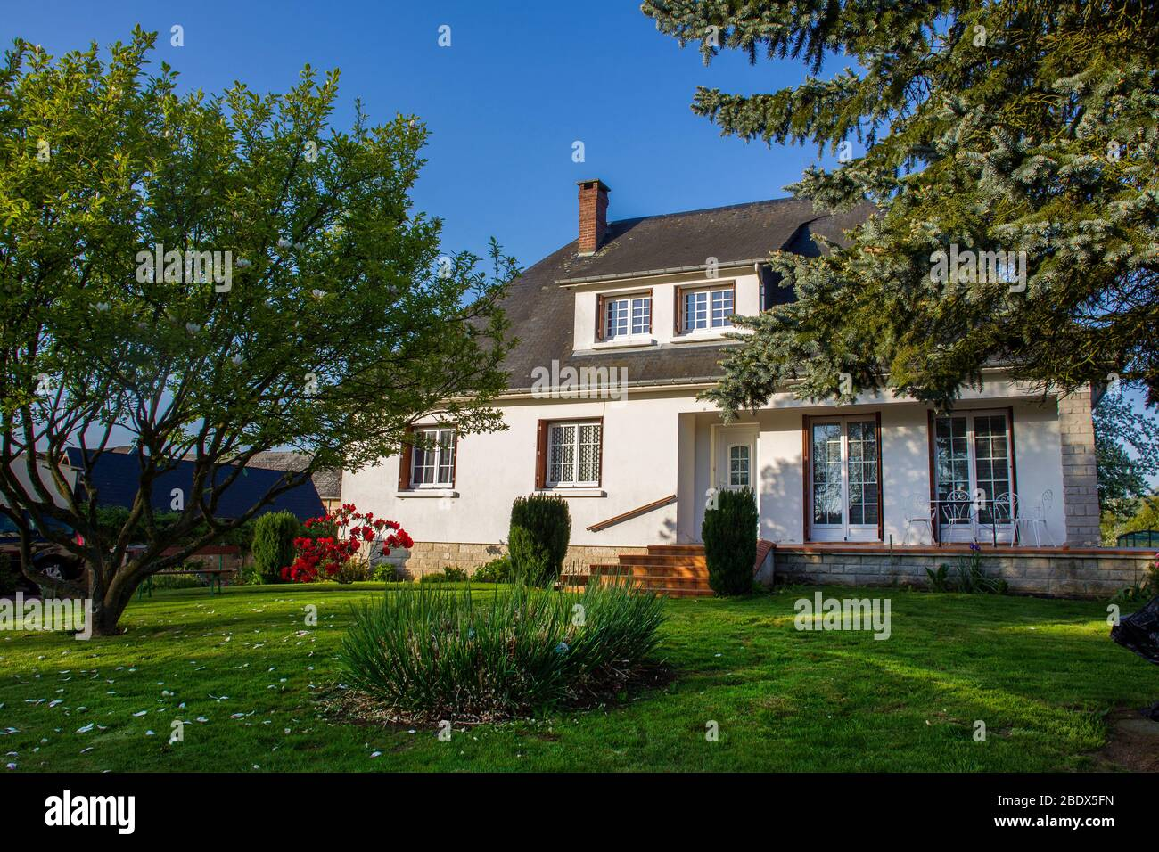France Country Idyll Springtime In Normandy White Country House At Sunset Sunbeams Stock Photo Alamy