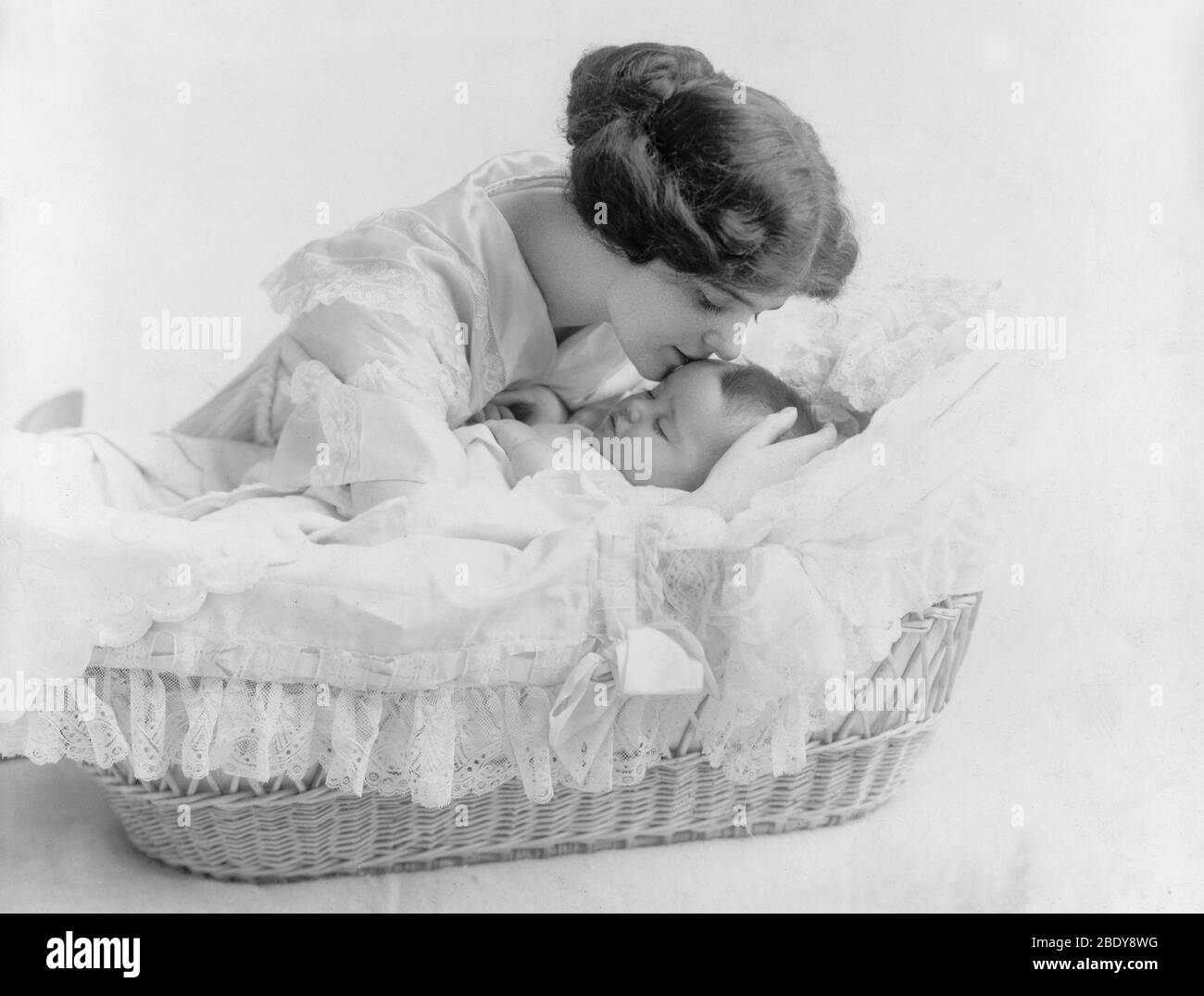 A Mother's Kiss, 1912 Stock Photo