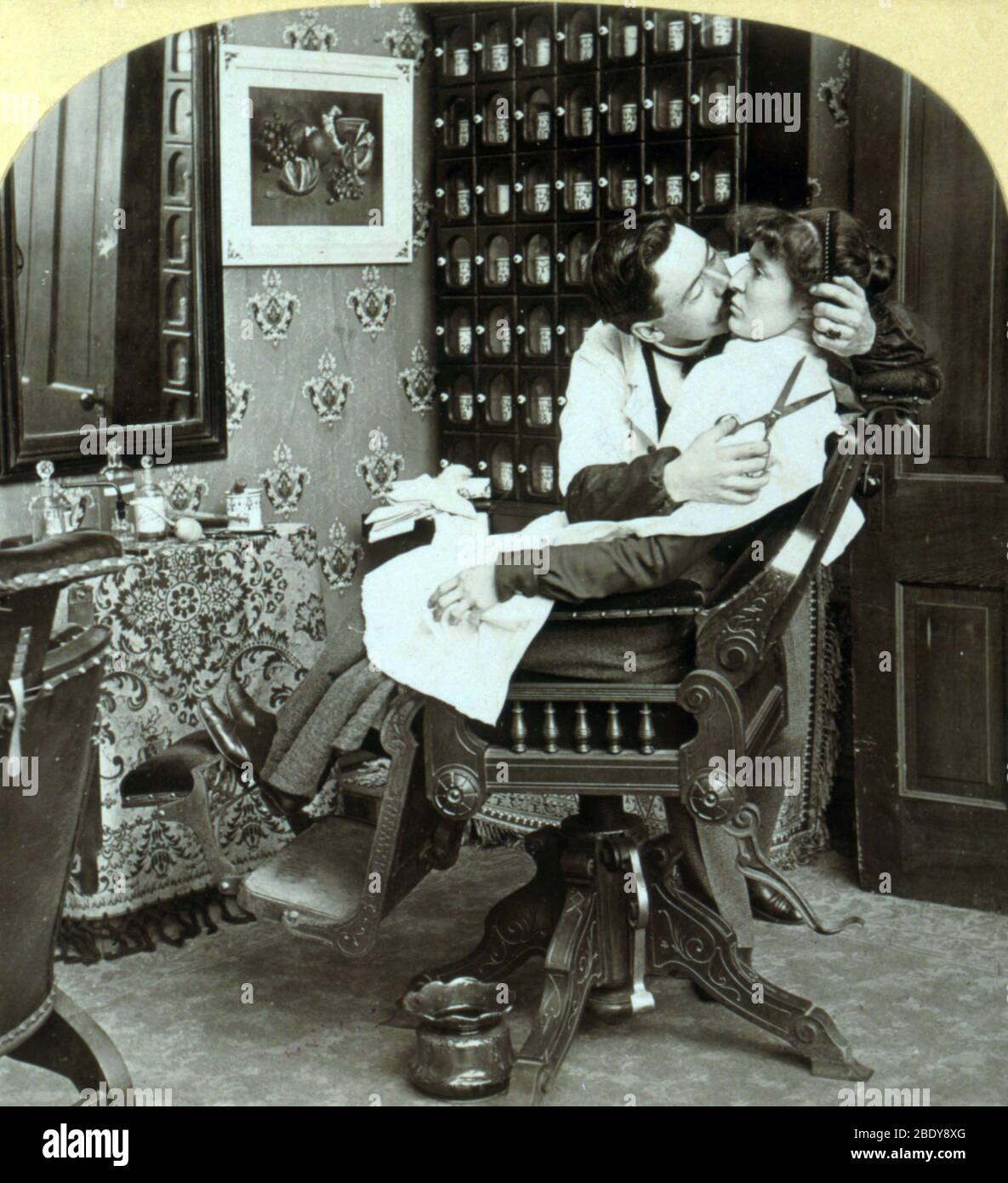"""""""Getting Her Hair Banged"""", 1900 Stock Photo"""