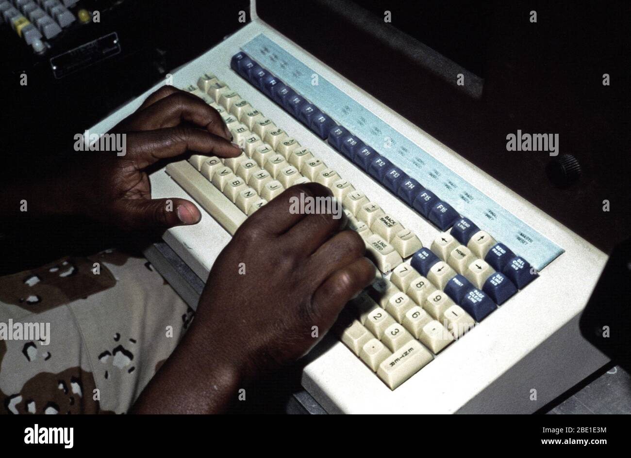 A radioman of the Joint Communications Support Element checks a computer terminal for the day's incoming messages.  He is participating in Exercise SHADOW HAWK '87, a joint Jordan/US Exercise within Exercise BRIGHT STAR '87.  SHADOW HAWK is a combined effort of the US Central Command and the Joint Chiefs of Staff. Stock Photo