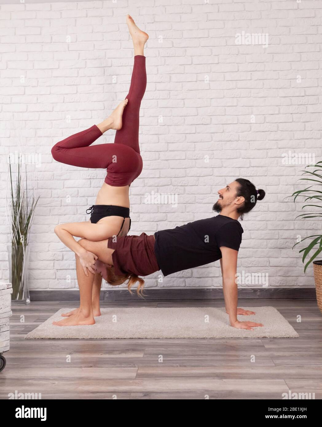 Young Couple Having Fun At Home With Some Acro Yoga Poses In Different Places Stock Photo Alamy