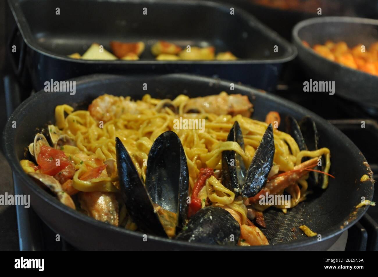 Tagliolini allo scoglio or spaghetti with seafood served i with shrimps and other shells Stock Photo