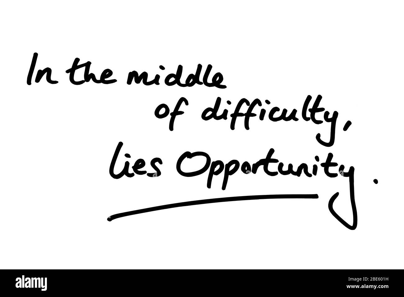 In the middle of difficulty, lies opportunity, handwritten on a white background. Stock Photo