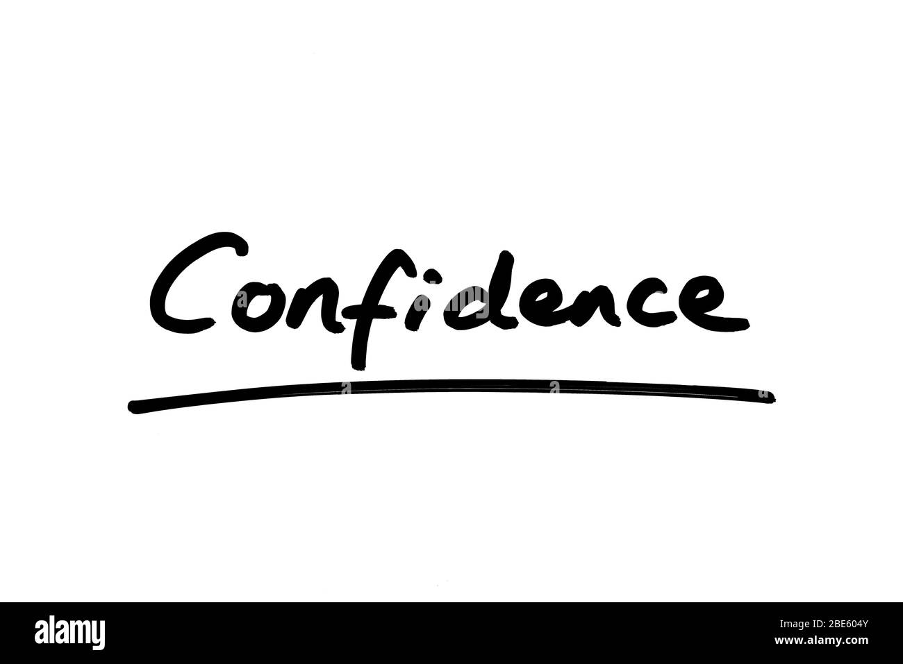 Confidence handwritten on a white background. Stock Photo