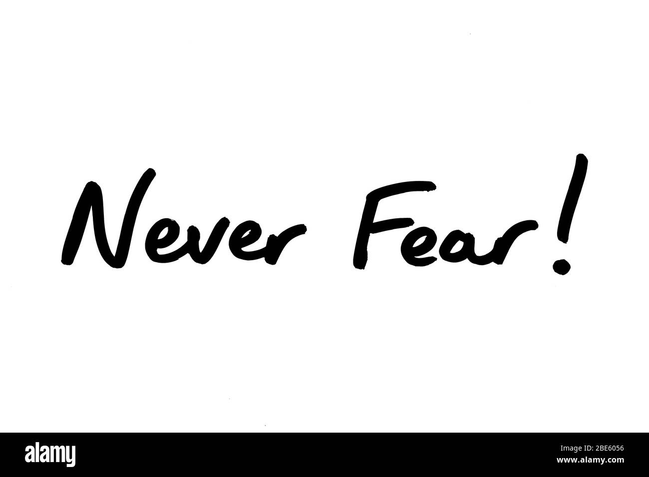Never Fear! handwritten on a white background. Stock Photo