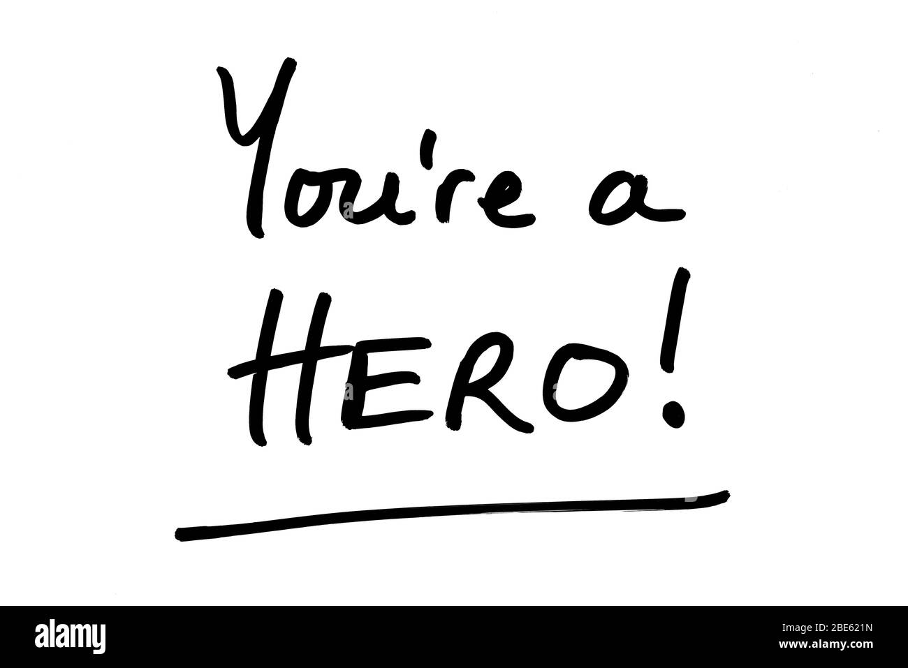 Youre a Hero! handwritten on a white background. Stock Photo