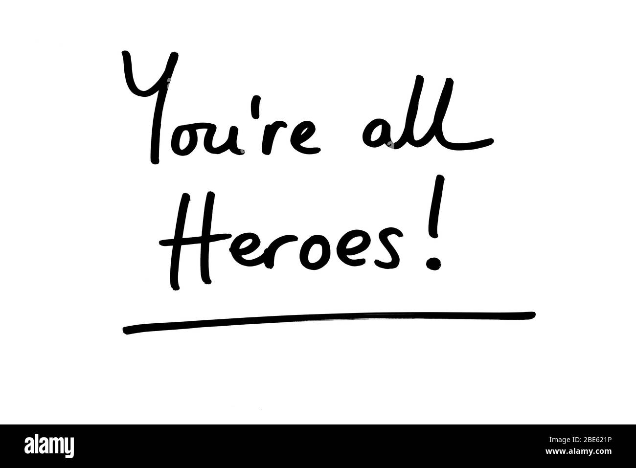 Youre all Heroes! handwritten on a white background. Stock Photo