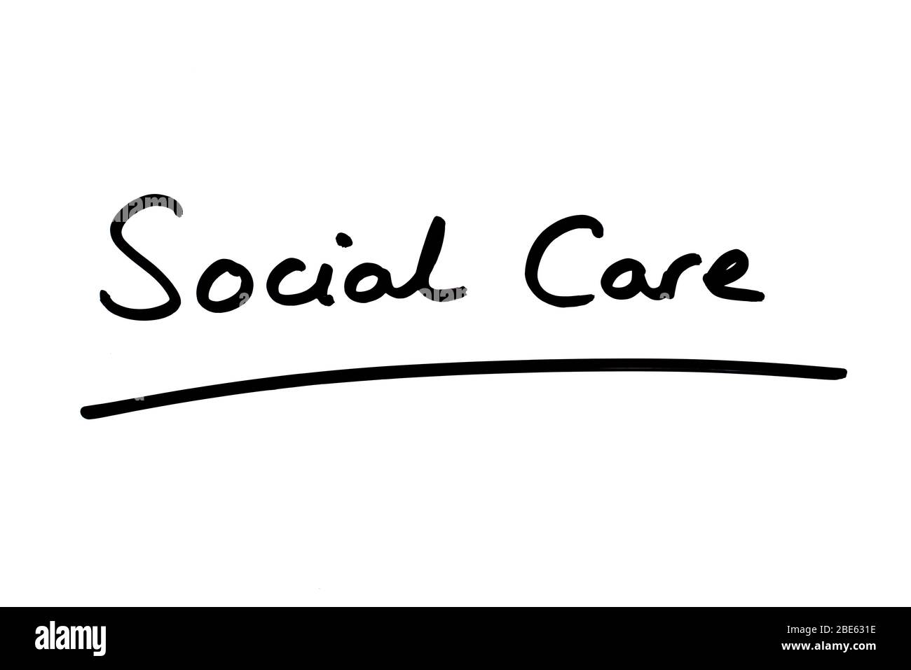 Social Care handwritten on a white background. Stock Photo