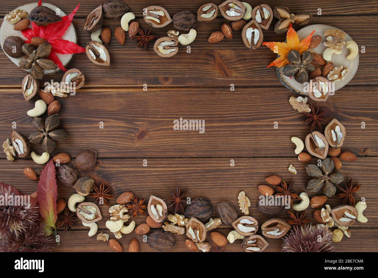 Nuts and Leaves Background Stock Photo