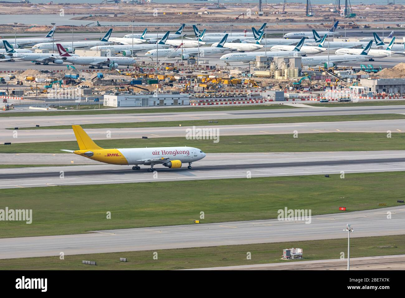 Lantau, Hong Kong  - April 10, 2020 :  Air Hong Kong's cargo airplane is runing for take off at runway, all parking space is fully occupied because of Stock Photo
