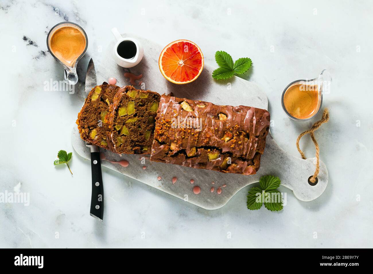 apple homemade vegan loaf cake with icing and espresso coffee. healthy morning breakfast or snack Stock Photo