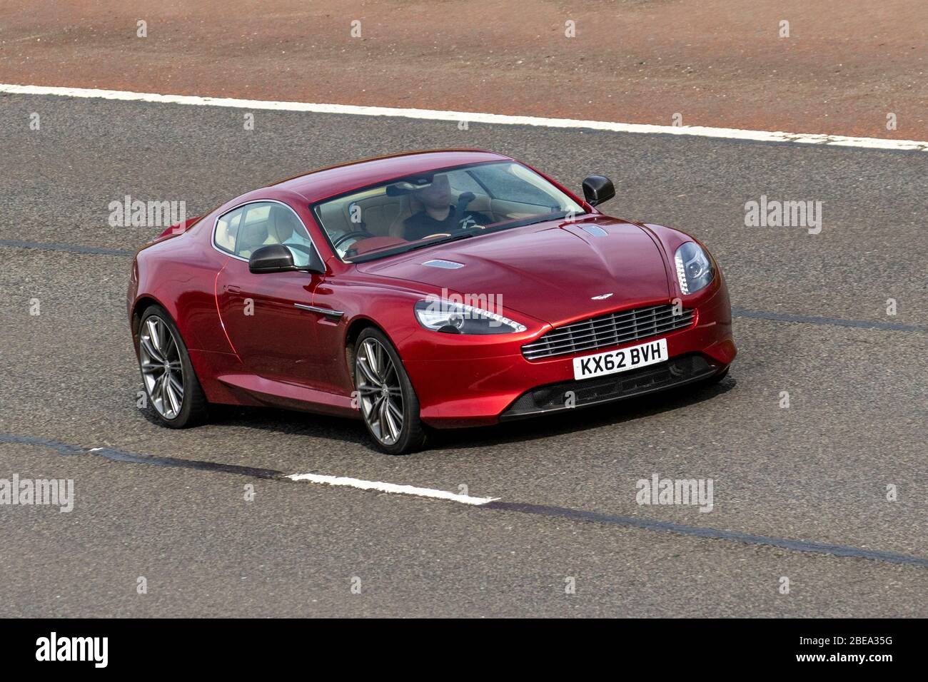 2012 Red Aston Martin Db9 5 9 Touchtronic Ii 2dr 2 2 2 Door Automatic Petrol Coupe Vehicular Traffic Moving Vehicles Driving Vehicle On Uk Roads Motors Motoring On The M6 Motorway Highway Stock Photo Alamy