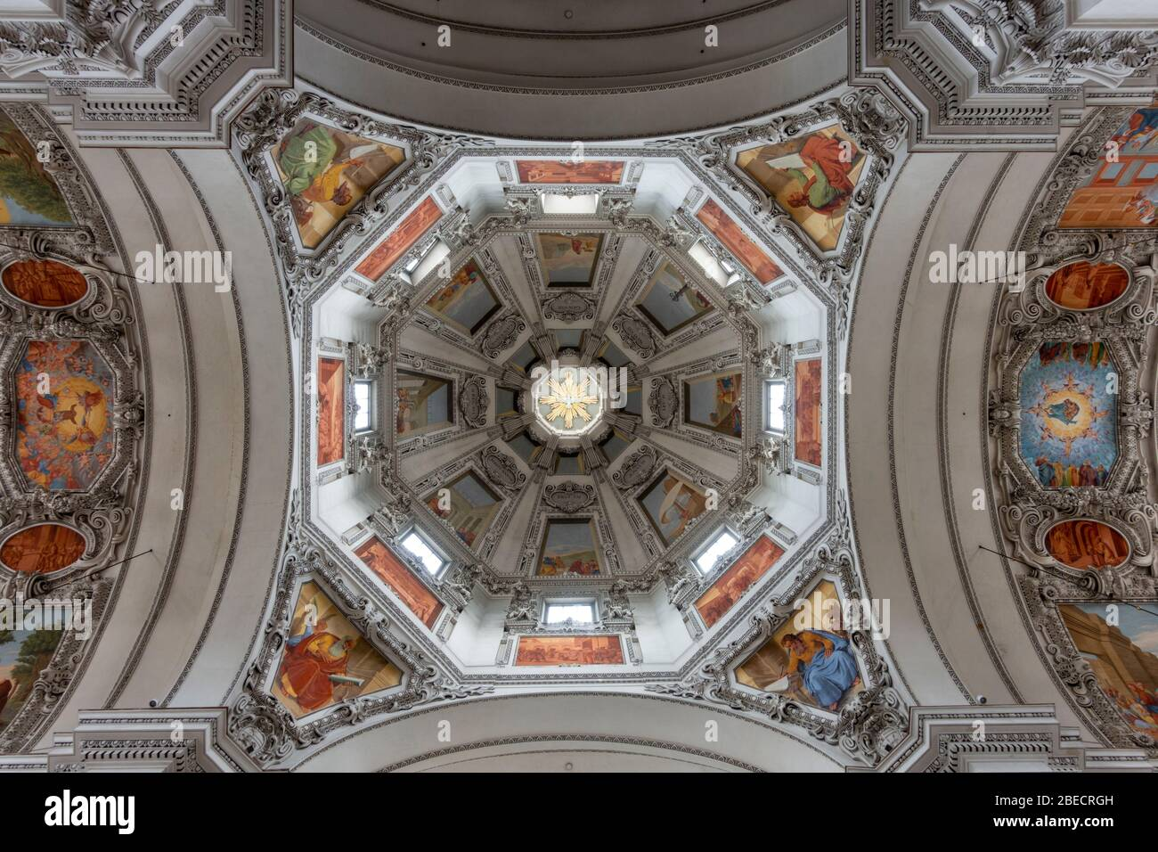 View looking straight up at the stunning ceiling of the main nave and dome inside Salzburg Cathedral (Dom zu Salzburg), Salzburg, Austria. Stock Photo